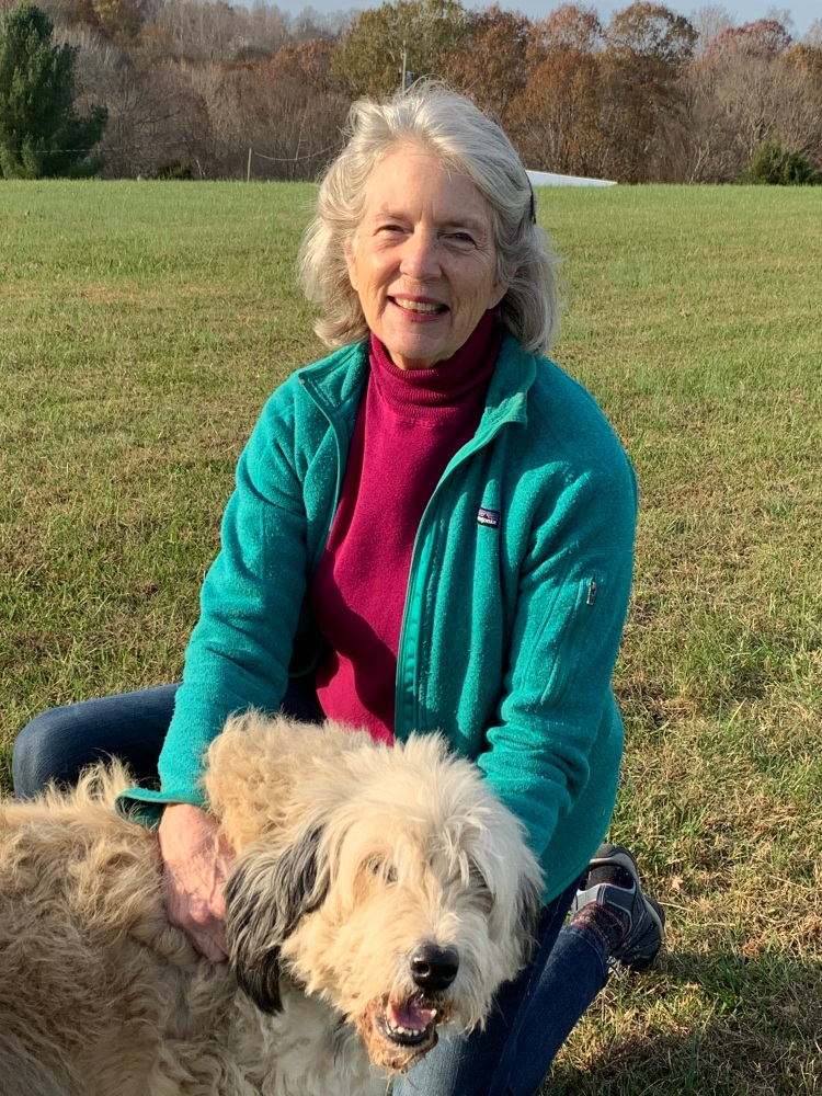 A photo of writer Georganne Harmon with her dog
